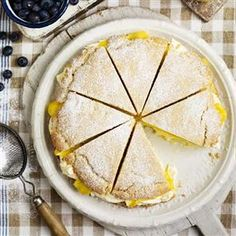American shortcake with lemon curd and clotted cream recipe - Curd and cream is a match made in heaven, and with this recipe you can try other flavours too, lime, passion fruit and grapefruit all work well. <<Oh, yum. Yummy Treats, Sweet Treats, Yummy Food, Shortcake Recipe, Lemon Desserts, Party Desserts, Clotted Cream, Home Baking, Baking Recipes