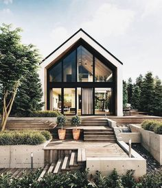 The body of the building is a modern barn. Fragments of the wooden facade perfectly harmonize with the green walls of the garage. The leitmotif of this project is the green wall that appears not only on the. Modern Barn House, Modern House Design, Modern Cabins, Cabins In The Woods, House In The Woods, Wooden Facade, Prefabricated Houses, Cottage Design, Cabin Design