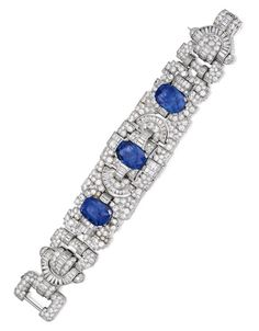 Platinum, Sapphire and Diamond Bracelet: The openwork bracelet of geometric design, set with three antique cushion-cut sapphires weighing 16.08, 15.80 and 14.61 carats, accented by numerous baguette, old European and single-cut diamonds weighing approximately 34.50 carats, length 7½ inches, numbered 1744.