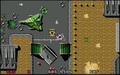 """Nitro is a top-down perspective racing video game for the Amiga and Atari ST. It was developed by Psygnosis and published in 1990.  This game contains no clear background or storyline, just white-knuckle video game racing. After choosing whether to play with one, two or three (via keyboard) players, the player(s) must select a car and buy accessories at the """"pit stop"""" before proceeding to the race. Three vehicles are available; namely the racing car, sports car, and turbo buggy. 90s Video Games, Gaming Computer, Keyboard, Perspective, Nintendo, Racing, Play, Vehicles, Sports"""