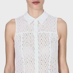 This Broderie Anglais shirt by Karen Millen is perfect for summer days in the city.
