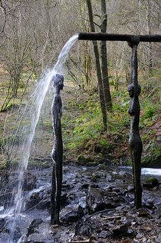 Bean An T-Visce (Lady of the Water) by Alannah Robins in Cumbria, England    This is a quite magical work, which comes alive in the wood's speckled light.