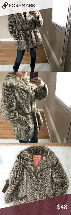 "Vintage Faux Fur Coat Multi shades of brown and ivory. Big collar. Cute buttons. Comes with belt as well. Size unknown. Beat guess is Medium to Large. Bust is 42"". Waist is 36"". 33"" long. I usually like to wear a medium in coats and am a size 2 in photo. Great condition. Vintage Jackets & Coats"