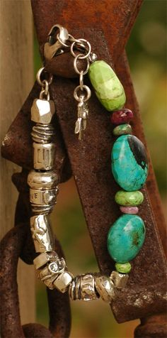 Spirit in the Sky....  Beautiful artisan handcrafted sterling silver beads--hand carved from wax then cast. Turquoise, Gaspeite, Stichtite and Russian Charoite. Adjustable 7 to 8 inches