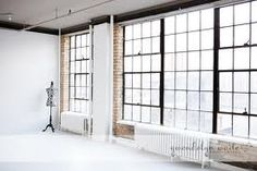 If I could have a studio the it would be similar to this. Big windows white walls and a white floor.