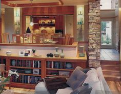Like the layout with a family room a couple of steps down from the kitchen/dining. Like the built in bookshelves too.