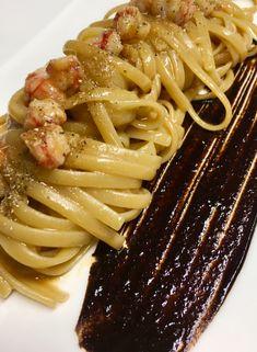 Trenette pasta with red prawns, green cardamom and black garlic cream