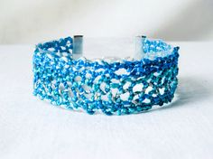 bracelet handmade bobbin lace out of bead yarn by UliBaysie, €24.90