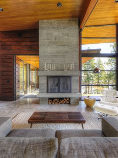 Love idea of built in fire log storage and mantle. Nice materials and textures too.