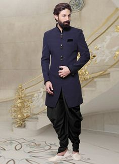 Buy Navy Blue Dhoti Style Indo Western Sherwani online, SKU Code: This Blue color indowestern sherwani for Men comes with Blended Cotton. Mens Indian Wear, Mens Ethnic Wear, Indian Groom Wear, Indian Men Fashion, Mens Fashion Suits, Fashion Black, Trendy Fashion, Mens Wedding Wear Indian, High Fashion Men