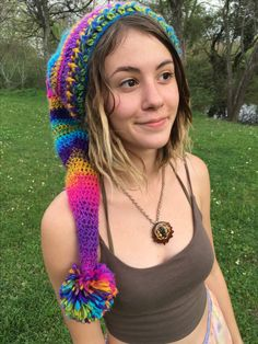 https://www.etsy.com/shop/TheMoonFaes?ref=search_shop_redirect  Pointed rainbow colorful neon gnome crochet hat with puffball handmade hats hippie hippy fashion style festival festy party costume weird goblin fairy fae pixie bohemian one of a kind