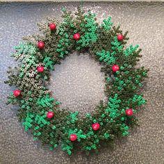 Christmas wreath hama perler beads by millehimmel - Pattern: http://www.pinterest.com/pin/374291419002724088/