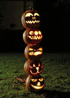 Make a carved pumpkin totem pole for outdoor Halloween decor.