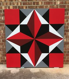 Barn quilt done in exterior grade MDO plywood and exterior paint. Would look great not only on a barn but also a garage or shed. Colors are: Red, Dark Red, Black, Gray and White. This barn quilt is done in 2x2. Barn quilts are made to order. Please allow 1 -2 weeks.