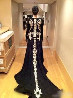 Skeleton costume with long dress and tail. I love this
