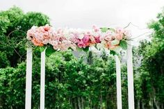 pink floral ceremony arbor / floral design www.passionroots.com / photo by ashley goodwin photography
