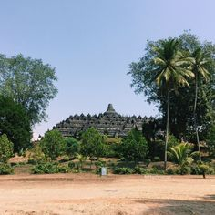 Borobudur from a far  ( It was built by a Buddhist kind and finished by a Hindu King )