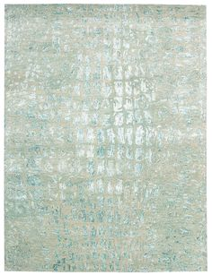The soothing green tones of Jade gleam with fascinating beauty in this marvelously modern rug. Its abstract shapes sparkle like the facets of a well-cut gem. Soft and textural, it brings a world of subtle elegance into the home. Luster, dimension...