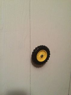John Deere room. Toy tractor tires used as closet knobs.
