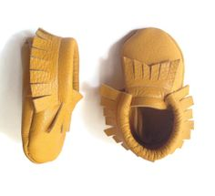 These adorable handmade moccasins are found on www.iDachuBaby.com with free shipping!