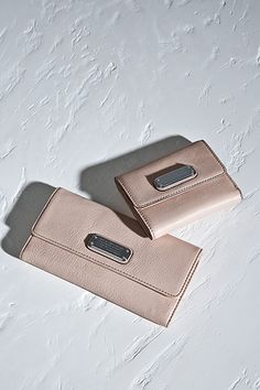 The Marc Jacobs New Q Long Trifold and Billfold in Tropical Peach.