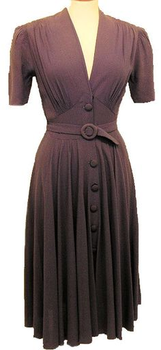 style of dress.  different belt/buttons.  shorter and different sleeves.  i like the gathering and v neck
