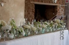 White and green wedding - small containers for a simplistic bridal table look