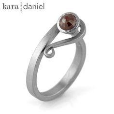 rose-cut natural colored diamond ~ stainless steel capture scroll ring.
