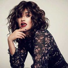 24. Curly Hairstyle with Bangs 2017