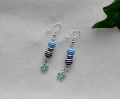 Drop Beaded Earrings with Dark and Light Blue Striped Colored Beads and Silver Plated Blue Flower Charm