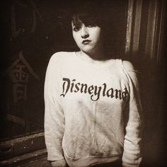Sweatshirt of the Day it's Lydia Lunch wearing a ripped Disneyland top. #lydialunch #disneyland #wornfree #tshirtoftheday