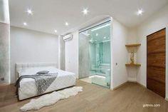 Moderna habitación integrada al baño gracias al vidrio