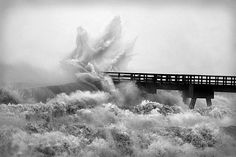 Waves hit Navarre Pier hard during Hurricane Ivan's approach: Navarre Beach, Florida by State Library and Archives of Florida, via Flickr