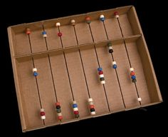 """Abacus (420-145) from Guildcraft Arts & Crafts! Make your own working abacus, and teach kids how people use this counting tool today. No cutting or gluing required. Includes ready-to-fold cardboard abacuses, precut cord and beads. 8"""" x 10 1/2""""."""