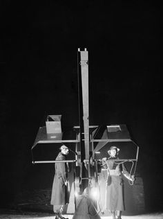 """Guard manning an anti-aircraft rocket weapon (known as a """"Z' Battery) at Bootle, Liverpool, January 1942."""