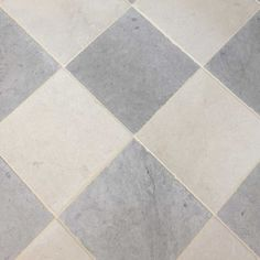 A cream and grey limestone checkered floor created using dense durable antiqued tiles. Perfect for high-traffic areas such as a hallway or kitchen. Limestone Pavers, Limestone Flooring, Natural Stone Flooring, Foyer Flooring, Kitchen Flooring, Kitchen Tile, Flooring Ideas, Floor Rugs, Tile Floor