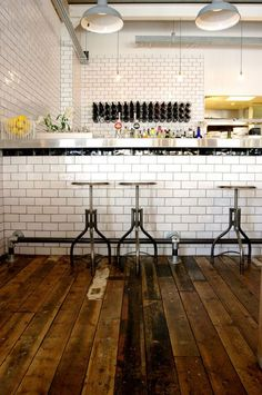 LOVE THE WHITE SUBWAY TILES AND TOLEDO STOOLS.