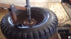 Tire Changer by Plowboy -- Homemade manually-operated tire changer and bead breaker fabricated from square tubing, black iron pipe, angle iron, and steel plate. http://www.homemadetools.net/homemade-tire-changer-6