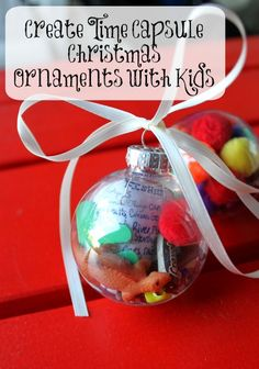 Create sweet and simple DIY time capsule Christmas ornaments with your kids to preserve memories for years to come {free printable}. #holiday #FestiveFamily