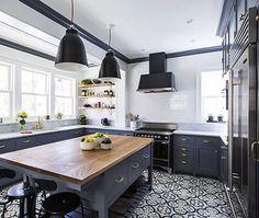 dark grey cabinets + white + pattern flooring