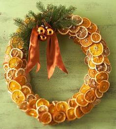 Love this beautiful dried orange slice wreath—embellished with evergreen branches • golden mini ornaments • burnt orange ribbon❣ Le Petit Chateau