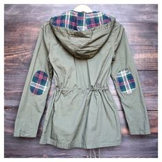 • Plaid Utility Jacket • This beautiful olive and plaid utility jacket is perfect for the chilly season! Unlined jacket that features plaid on the hood and elbows, zipper and button up front and two functional pockets. 100% cotton   PLEASE DO NOT purchase this listing. Comment what colors you'd like below and I'll make a listing for you. Thank you! Jennifer's Chic Boutique Jackets & Coats Utility Jackets