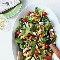 We've pumped up Grilled Shrimp and Spinach Salad with a colorful mix of sliced mangoes, fresh rapsberries, goat cheese, and of course, grilled shrimp.