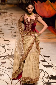 Former Miss India, Amruta Patki displays a creation by designer Rohit Bal on Day 4 of India Bridal Fashion Week in New Delhi on July 25, 2013.