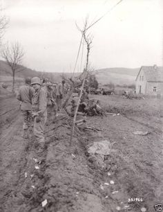 4th Infantry Division soldiers examine jeep after landmine