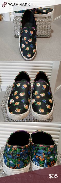 Coach shoes Black Coach shoes with blue,peach and white flowers. Used condition. Still in really good shape. Took very good care of them. Size 7. Love them but i replaced them with another pair just like these from posh that fit my feet better. Coach Shoes Sneakers
