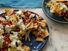 Greek Nachos:  Why serve average chip-and-cheese recipes when you can make these inventive nachos, smothered with meats, sauces and everything in between?