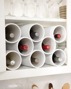 Wine Bottle Storage, modern wine rack is made of PVC pipe from a hardware store. The design is completely flexible, so you can create one to fit inside any shelf or cabinet and paint it to suit your own decor. How to Make the Wine Bottle Storage Kitchen Storage Solutions, Kitchen Organization, Organization Hacks, Organizing Ideas, Kitchen Organizers, Organized Kitchen, Wine Bottle Storage, Bottle Rack, Wine Racks