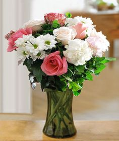 Charm your way into her heart with this lovely bundle of pink and peach roses romancing with two-tone pink and white carnations and white chrysanthemums.