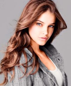 she's so stunning. nice warm knit cardi with hair did and light makeup